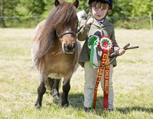 'We did it - first competition rosette in a young handler class'