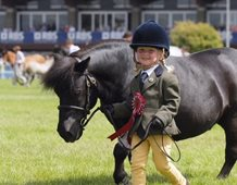 Anna Marshall, 4, with Harviestoun Rhuri, 21, in the Grand Parade at the Royal Highland Show after coming 6th in the gelding class.